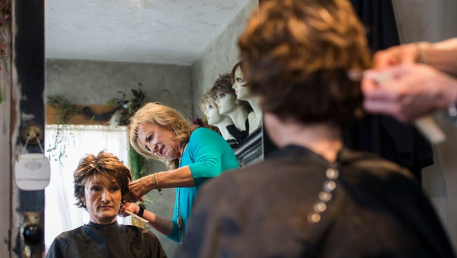 Nancee Testa, the owner of Mane Door Salon, styles the wig of breast cancer patient and Greeley-based property brokerage specialist Pam Zimmerman-Maize on Monday, April 30, 2018, at Mane Door Salon in Fort Collins, Colo. Mane Door Salon is one of two local salons that have built a reputation for modifying the fit and style of wigs for clients.