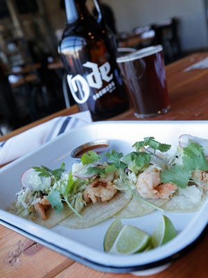 Ode Brewing's Shrimp Tacos pair nicely with the company's in-house-brewed Amber Lager. The restaurant and brewery offers a full, sophisticated, yet laid-back menu. The beer at Ode is handcrafted by brew master Albert Salinas.