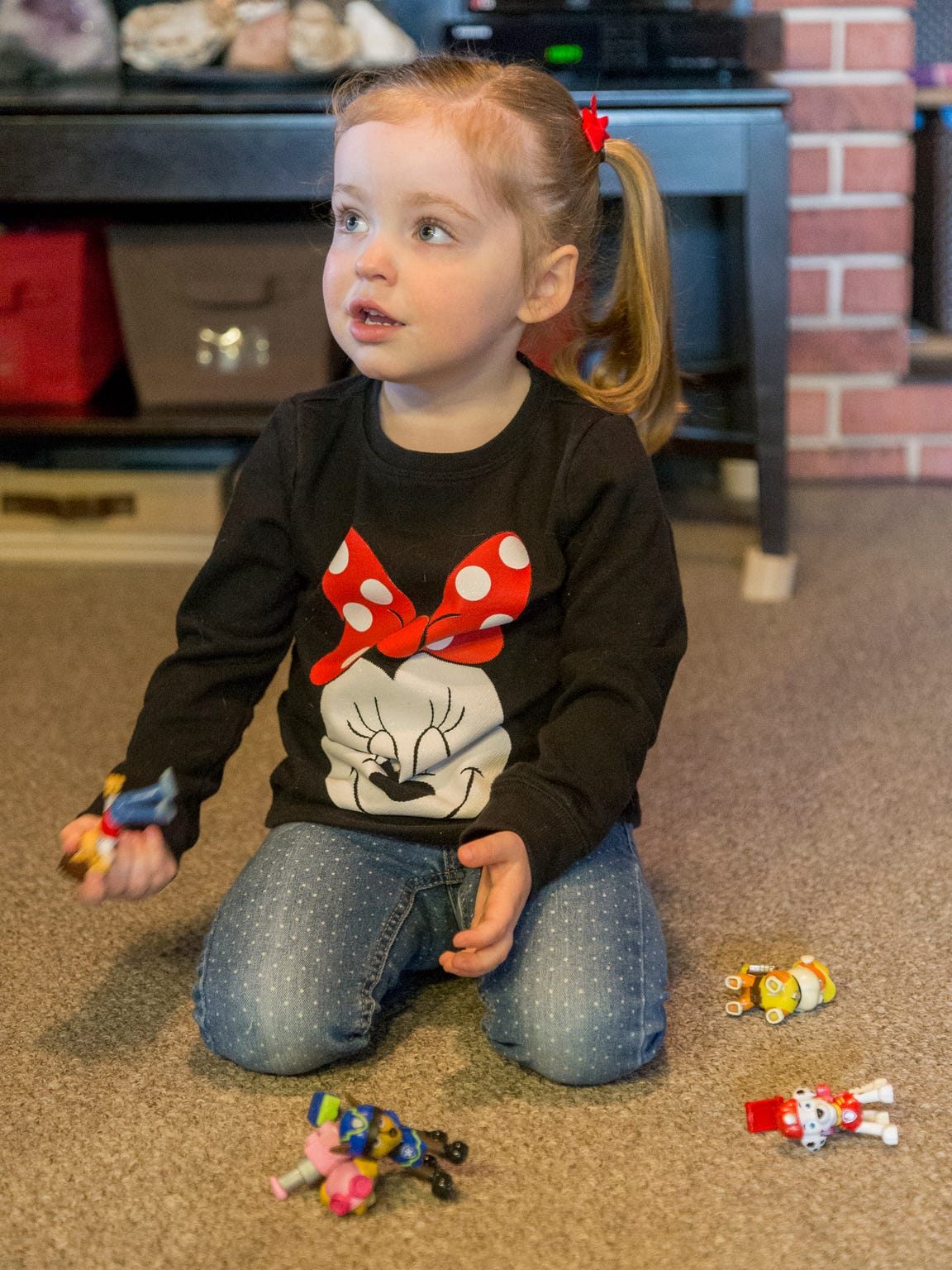 Jude Gellatly, 2, plays in the family's Freeville home.