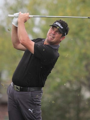 Eric Axley chips from off the fairway during the first round of the Web.com Louisiana Open at the Le Triomphe on Friday.