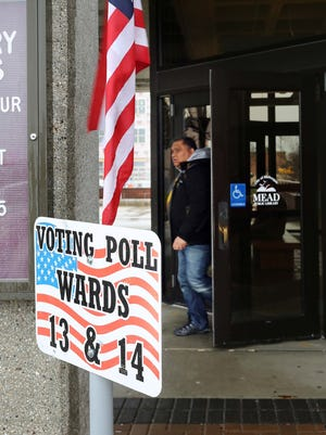 A man leaves the Mead Public Library polling place Tuesday April 4, 2017 in Sheboygan, Wis.