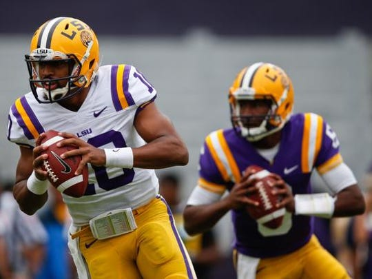 Tigers quarterback Anthony Jennings (10) and quarterback Brandon Harris (6) run drills during the 2014 spring game at Tiger Stadium.