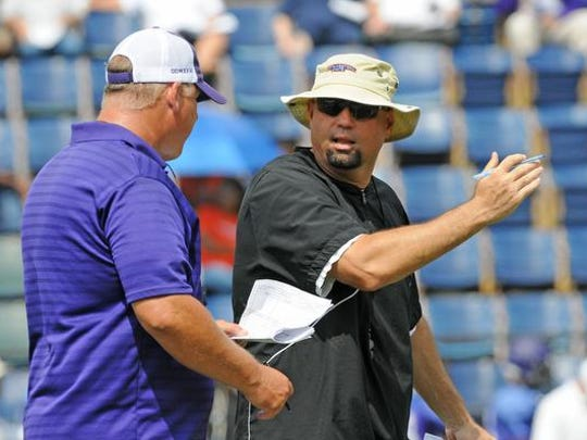 Northwestern State offensive coordinator Ben Norton (right) talks with Demons coach Jay Thomas during spring practice. Norton has taken over as the Demons' offensive coordinator but will continue to run the same system implemented by his predecessor, Robby Brown, last season.