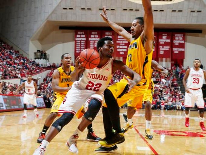 Dec 22, 2013; Bloomington, IN, USA; Indiana University Hoosiers guard Stanford Robinson (22) drives to the basket against Kennesaw State Owls forward Nate Rucker (12) at Assembly Hall. Mandatory Credit: Brian Spurlock-USA TODAY Sports