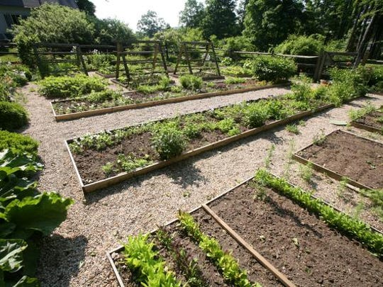 "The vegetable/cutting garden at the home of Page Dickey and her husband Francis ""Bosco"" Schell for sale in North Salem, June 3, 2014. The 1830 farmhouse includes grounds that cover nearly 3 acres, with pool, husband/pool house, greenhouse, wildflower meadow and many gardens."