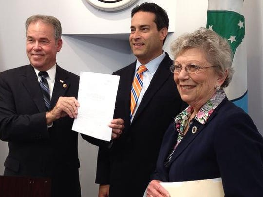 From left, Rockland County Executive Ed Day, county Legislature Chairman Alden Wolfe and Legislator Harriet Cornell celebrate Thursday after Day signed the resolution creating the new county Task Force on Water Resources Management at the Allison-Parris County Office Building in New City.