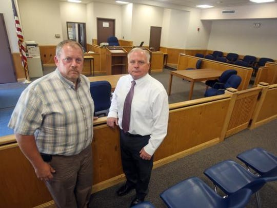 Haverstraw villlage Mayor Michael Kohut, left, and Haverstraw town Supervisor Howard Phillips stand in the Haverstraw town Justice Court July 8, 2014.