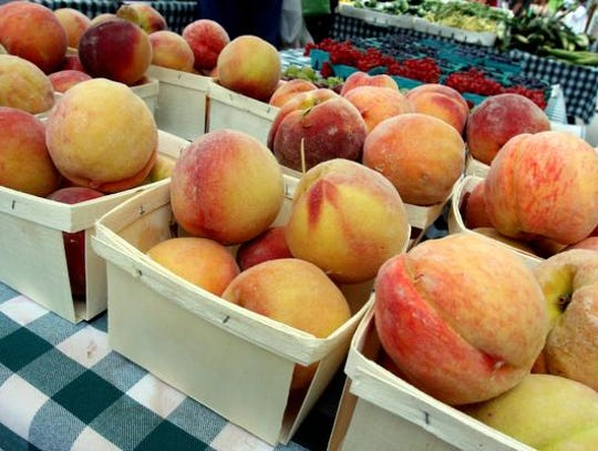 Peaches line the tables at the Tarrytown Farmers Market