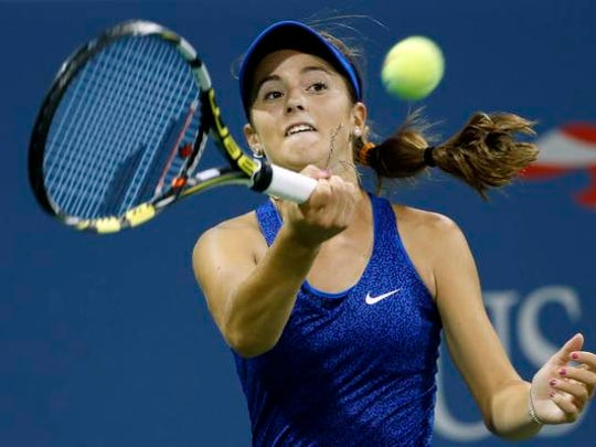 CiCi Bellis of the United States returns a shot to Zarina Diyas of Kazakhstan during the second round of the U.S. Open tennis tournament Thursday, Aug. 28, 2014, in New York.