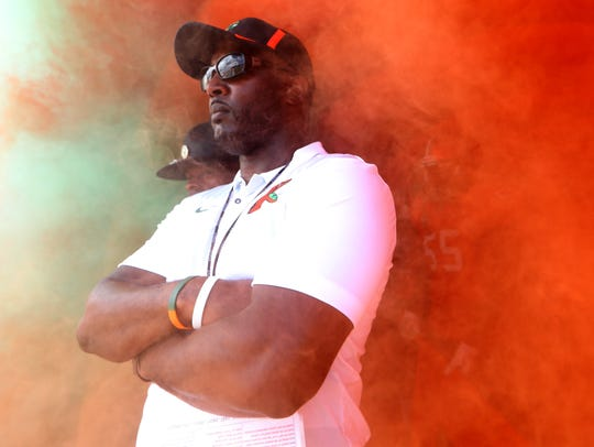 FAMU head coach Willie Simmons stands in the tunnel