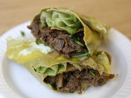 A Chinese crepe with Bulgogi beef filling from Crepe