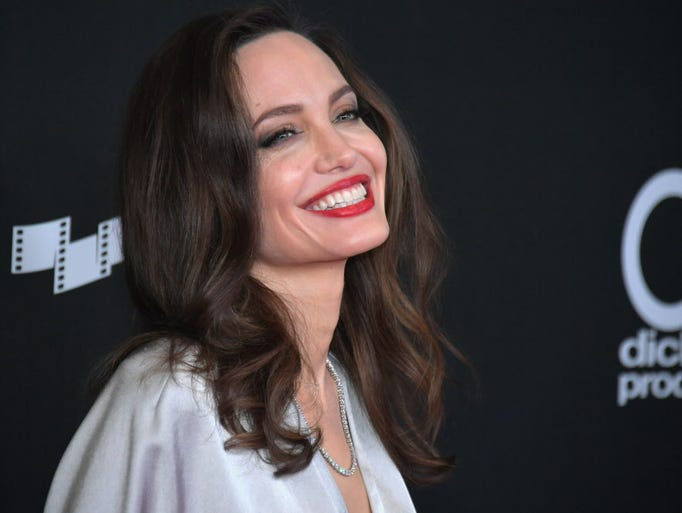 Angelina Jolie shimmered in silver at the 21st annual