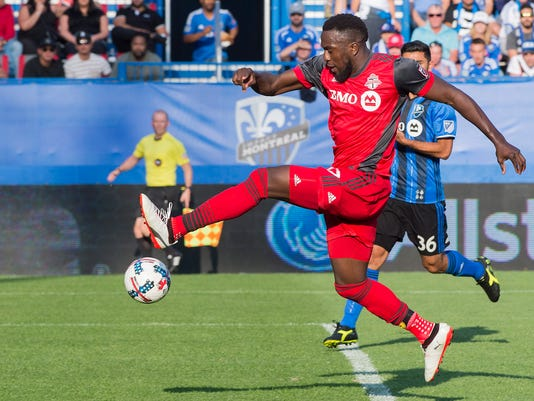 Toronto FC's Jozy Altidore scores against the Montreal Impact during second half MLS soccer action in Montreal, Sunday, Aug. 27, 2017. (Graham Hughes/The Canadian Press via AP)