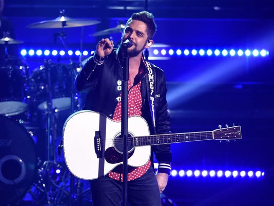 FILE - In this Nov. 8, 2017 file photo, Thomas Rhett performs at the 51st annual CMA Awards at the Bridgestone Arena on Wednesday, Nov. 8, 2017, in Nashville, Tenn. Rhett will be the halftime performer on Thanksgiving Day as the Dallas Cowboys host the Los Angeles Chargers. Rhett will lead Thursday's nationally televised halftime show at AT&T Stadium in Arlington to help kick off The Salvation Army's annual Red Kettle Campaign. (Photo by Chris Pizzello/Invision/AP)