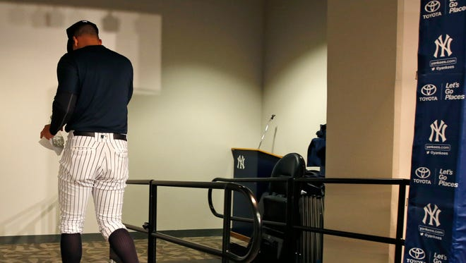 Yankees designated hitter Alex Rodriguez leaves the room, Sunday, Aug. 7, 2016, in New York, after announcing that Friday, Aug. 12, will be his last game as a player. Rodriguez will continue on in a role as a special advisor to the team and an instructor through Dec. 31, 2017.