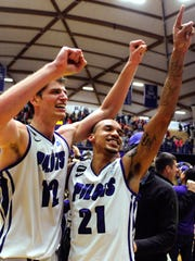 In this Jan. 9, 2014, file photo, University of Portland basketball player Korey Thieleke (21), right, and teammate Thomas van der Mars (12) celebrate after beating Gonzaga in an NCAA college basketball game in Portland, Ore.