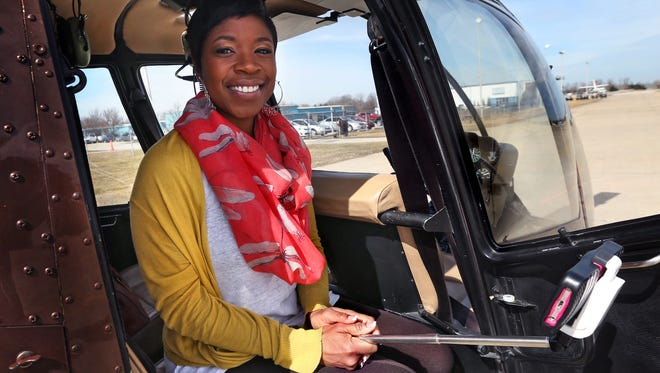 "Tracey Bonner, from Atlanta, approaches Downtown as she goes on a ""date"" with herself — a helicopter tour of Indianapolis, courtesy of Freedom Helicopters pilot Joe Newkirk. Bonner, an actress, is in Indianapolis for nearly a month while performing in a show at the Indiana Repertory Theatre."