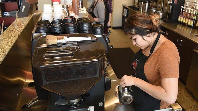 Samatha Dawes makes an espresso drink on Friday at the new Durango Joes Coffee location in the Farmington Plaza.