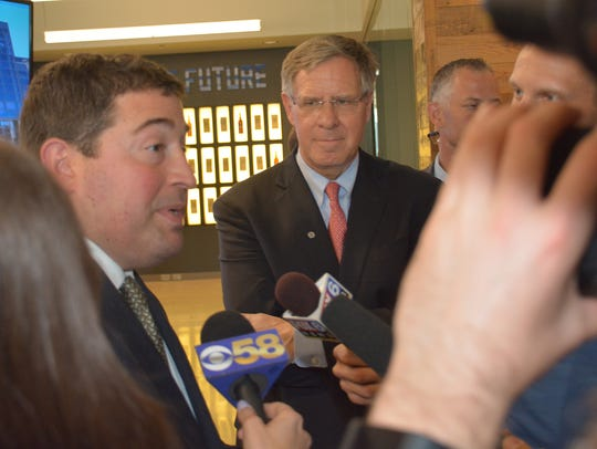 Milwaukee Bucks president Peter Feigin (left) and David