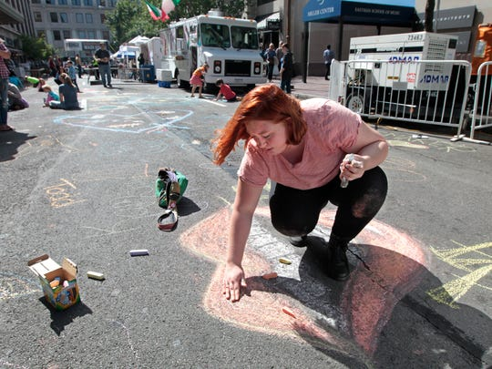 Kennedy Cottrell, 17, Rochester, blends chalk colors