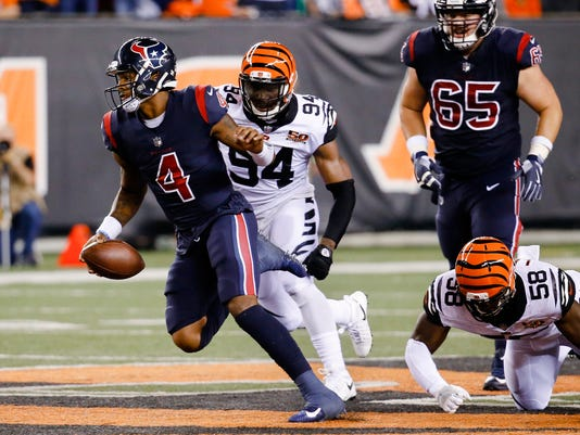 Houston Texans quarterback Deshaun Watson (4) breaks away from Cincinnati Bengals defensive end Chris Smith (94) and linebacker Carl Lawson (58) to score a touchdown during the first half of an NFL football game, Thursday, Sept. 14, 2017, in Cincinnati. (AP Photo/Frank Victores)