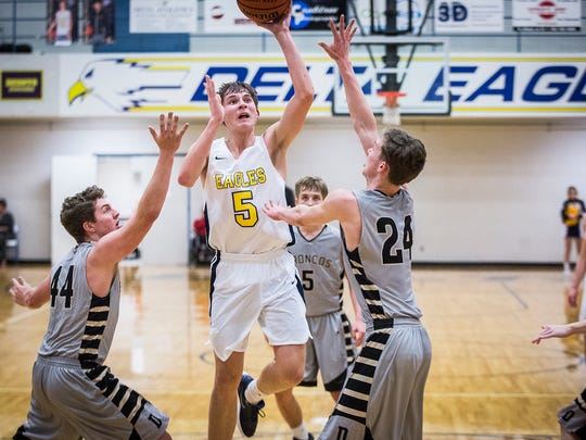 Delta's Josh Bryan shoots past Daleville's defense during their game at Delta High School Tuesday, Jan. 9, 2018.