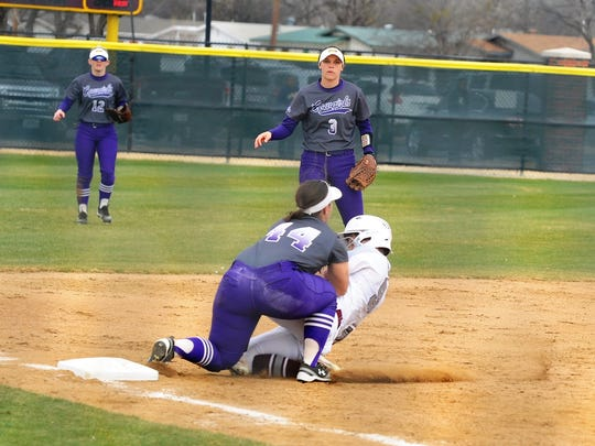 Hardin-Simmons third baseman Rachel Dugan tags out Trinity's Devon Potter during Game 1 of Saturday's doubleheader. The Cowgirls fell 5-2.