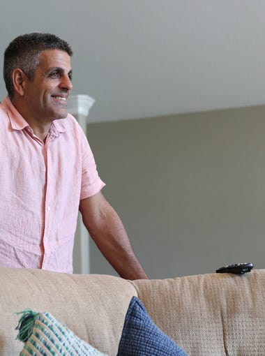 Rudy Blanco smiles at his family home in Perry, Fla.