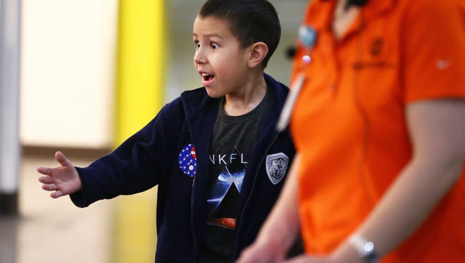 Ben Bicknese, age 8 from Tucson, reacts as he visits the Amazon Fulfillment Center PHX6 during a special tour on Jan. 10, 2017, in Phoenix, Ariz. Amazon hosted a scavenger hunt for Bicknese, which concluded in several gifts given to the 8-year-old and his family, including an Amazon Echo speaker and a Star Wars Lego kit.