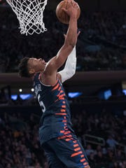 New York Knicks guard Dennis Smith Jr. goes to the basket during the second half of the team's NBA basketball game against the Washington Wizards, Sunday, April 7, 2019, at Madison Square Garden in New York. The Knicks won 113-110. (AP Photo/Mary Altaffer)