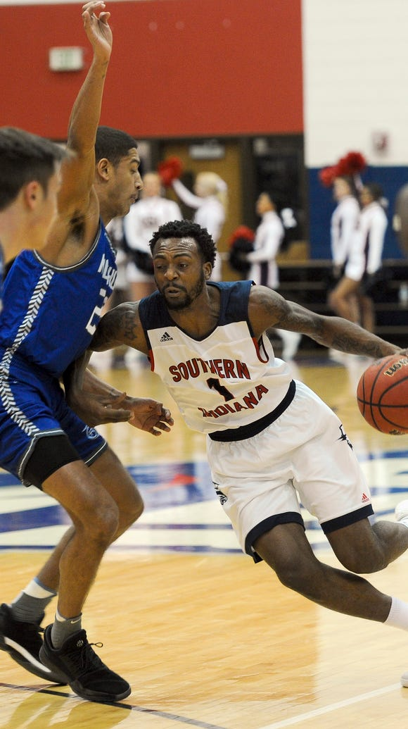 Southern Indiana's Jeril Taylor, right, drives against