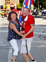Tina Schwartz and her son Alex, 23, break out into a polka dance when a band goes by at the Humboldt Park Fourth of July parade on Wednesday in Bay View. Members of the Schwartz family have been attending the parade for almost 30 years. There were four generations at the parade on Wednesday.