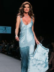 Janice Dickinson on runway in September 2005 in New