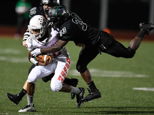 Bosse's Kordell Williams is tackled by North's Cage