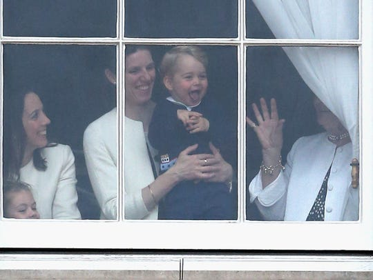 Prince George of Cambridge is held by his nanny Maria