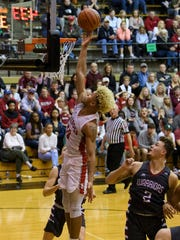 Bosse's Javen Layne (10) makes a layup during the IHSAA