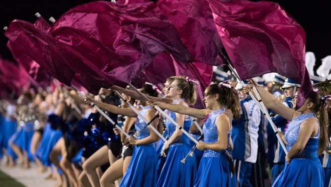 The Barron Collier band perfroms during halftime of the game agains Golden Gate at Golden Gate High School Friday night, October 14, 2016.