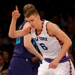 NEW YORK, NY - NOVEMBER 17: Kristaps Porzingis #6 of the New York Knicks celebrates a basket in the first half against the Charlotte Hornets at Madison Square Garden on November 17, 2015 in New York City.NOTE TO USER: User expressly acknowledges and agrees that, by downloading and/or using this photograph, user is consenting to the terms and conditions of the Getty Images License Agreement. (Photo by Elsa/Getty Images)