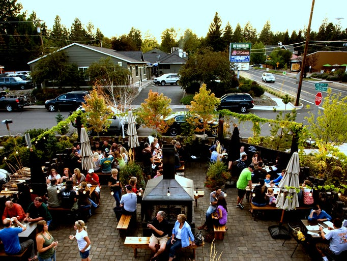 Guests crowd the 10 Barrel patio on a busy afternoon. The brewery has been a local favorite since its inception in 2006.