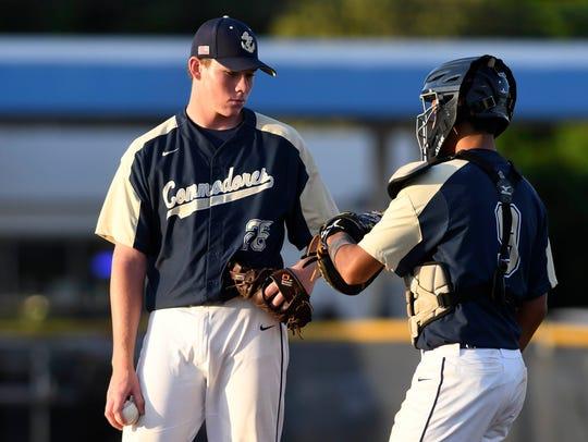 Eau Gallie pitcher Carter Stewart talks with catcher