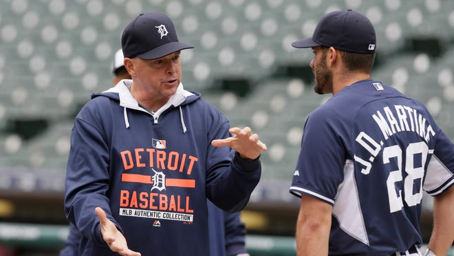 Detroit Tigers hitting coach Wally Joyner talks with right fielder J.D. Martinez, who was in a slump earlier this season and is now a home-run machine as of late.
