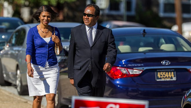 Dennis Willims and wife Shyne go to vote at Harlan Elementary School on Sept. 11, 2012.