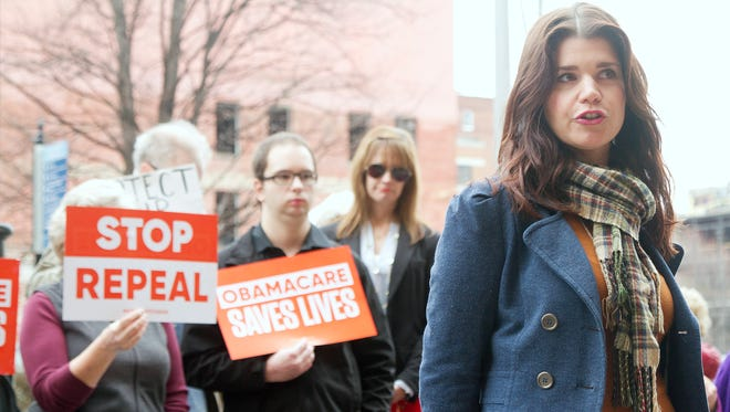 Cancer survivor Jessica Hendricks and other cancer survivors gather together Jan 19, 2017 in Knoxville, Tenn. to protest against the repeal of Affordable Care Act.