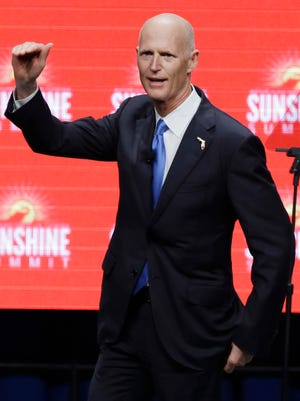 Florida Gov. Rick Scott addresses the Sunshine Summit in Orlando, Fla., Friday Nov. 13, 2015. (AP Photo/John Raoux)