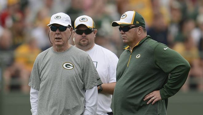 Green Bay Packers general manager Ted Thompson (left) and head coach Mike McCarthy.