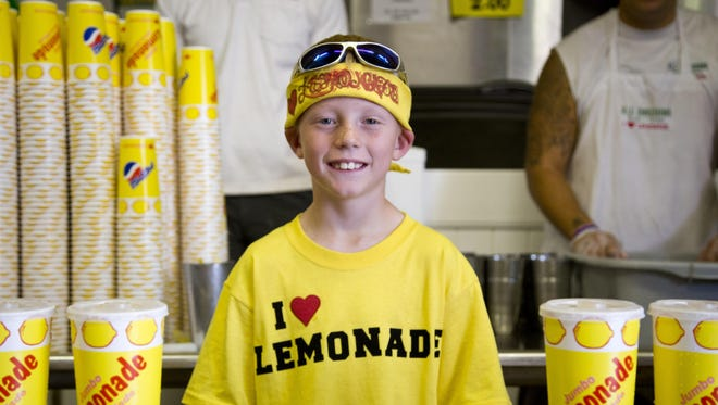 "Dylan Salois, 9, works as the ""boss"" of the Jumbo Lemonade stand in the Mercantile Building at the Montana State Fair in 2015. The fresh squeezed lemonade is a crowd favorite."