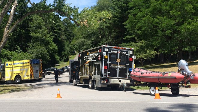 The Monroe County Sheriff's Office conducts an investigation at Mendon Ponds Park on Thursday, July 21, 2016.