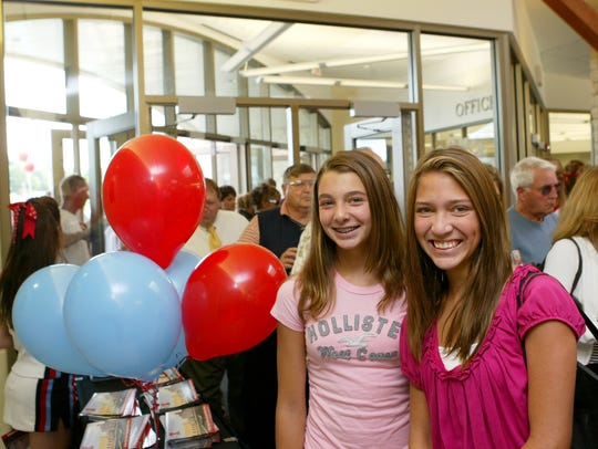 Sabrina Downey, left, enters Kings High School for