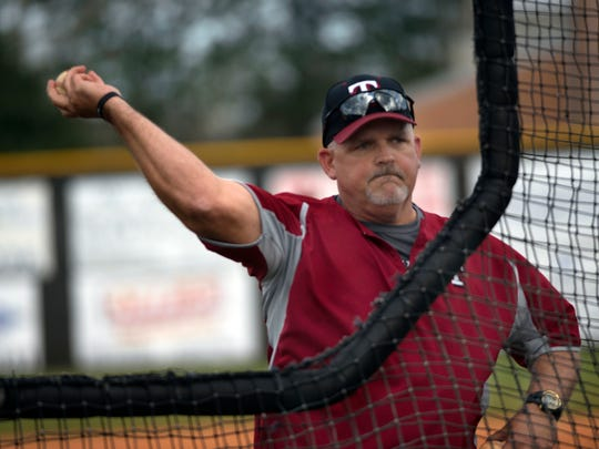 Tate High School Baseball coach Greg Blackmon gets his 3-0 team ready for Tuesday night's district 1-7A game against West Florida High School with a little batting practice.