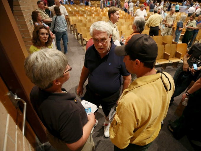 Residents at a community meeting for the Burro Fire